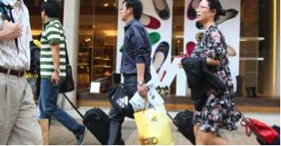 Mainland tourists shopping in Hong Kong