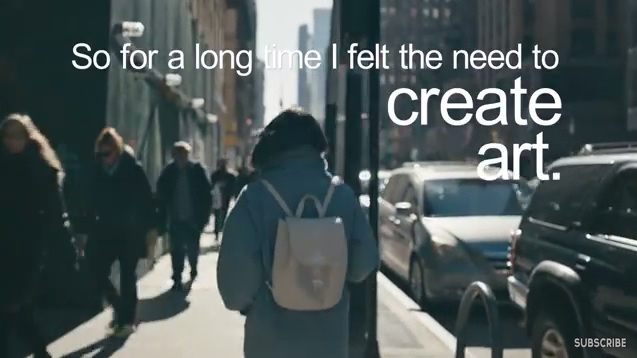 Screenshot of online video showing a person walking on a busy street