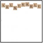 "Scrabble tiles spelling out ""vulnerable"""