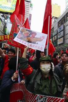 Hong Kong tourists donning Chinese Cultural Revolution Costumes