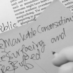 Hand writing on text with notes.